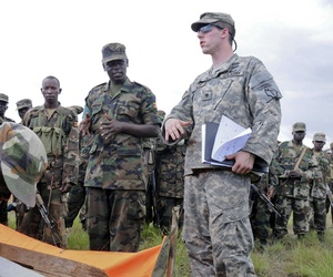 A soldier with the Georgia National Guard practice establishing drop zones with the Ugandan People's Defense Forces during an exercise sponsored by U.S. Army Africa.