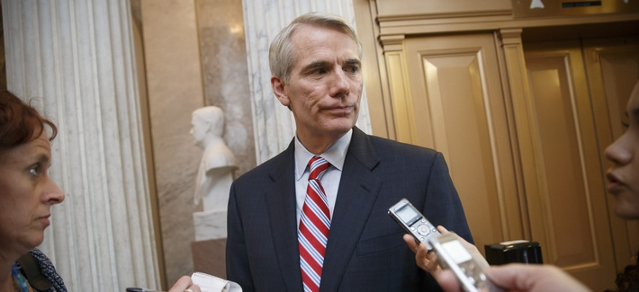 Sen. Rob Portman, R-Ohio, center, speaks with reporters at the Capitol in Washington, Monday, May 12, 2014. (AP Photo)