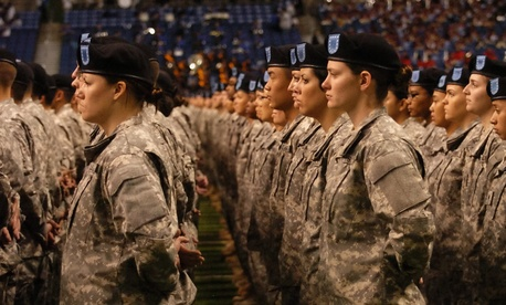 New soldiers take the oath of enlistment during a ceremony at the Alamodome in San Antonio, Texas.