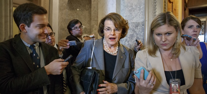 Senate Intelligence Committee Chair Sen. Dianne Feinstein, D-Calif., speaks to reporters as she leaves a Democratic Caucus meeting on Capitol Hill.