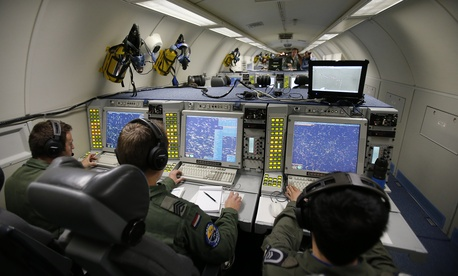 The E-3A AWACS Component crew of a NATO AWACS plane control computer and radar screens during a patrol over Romania and Poland, Friday, April 18, 2014.