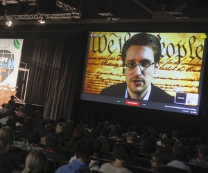 NSA leaker Edward Snowden speaks to participants via video conferencing at the South by Southwest Interactive Festival in Austin, Texas.