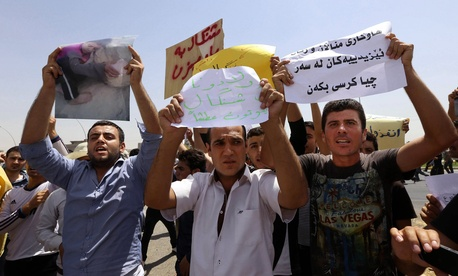 Iraqis from the Yazidi community in Irbil, Iraq, chant slogans pleading for international protection from ISIL militants.