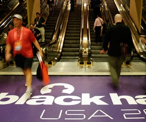 Hackers and security personal attend the Black Hat hacker conference.