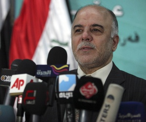 Iraqi lawmaker Haidar Al-Abadi speaks to the press following an Iraqi Parliament session.