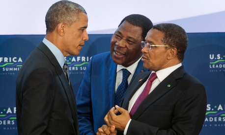 President Barack Obama, left, talks with Benin President Yayi Boni, center, and Tanzania President Jakaya Kikwete, right, at the start of the 3rd Session at the US African Leaders Summit, Wednesday, Aug. 6, 2014, at the State Department in Washington.
