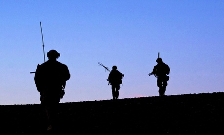 Marines with the 9th Marine Regiment crest a hill at the end of a patrol through Helmand province, Afghanistan.