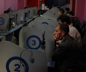 Syrians surf the internet and browse social networks at an Internet cafe in Damascus, Syria.