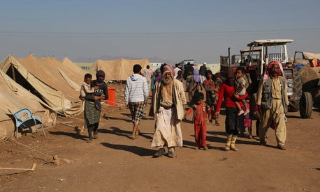 Displaced Iraqis from the Yazidi community arrive at Nowruz camp, in Derike, Syria, on Tuesday.