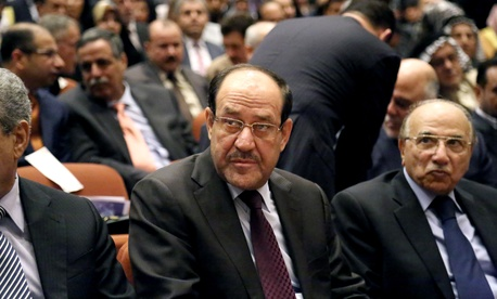 Iraqi Prime Minister Nouri al-Maliki attends the first session of parliament in Baghdad's Green Zone, on July 1, 2014.