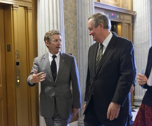 Sen. Rand Paul, R-Ky., and Sen. Mike Crapo, R-Idaho, speak after a procedural vote at the Capitol, on February 25, 2014.