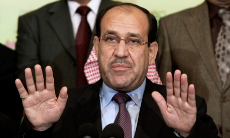 In this Friday, March 26, 2010 file photo, Iraqi Prime Minister Nouri al-Maliki speaks to the press in Baghdad, Iraq.