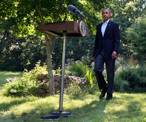 President Barack Obama arrives to speak about developments in Iraq, Aug. 11, 2014, from Chilmark, Mass., during his family vacation on the island of Martha's Vineyard.