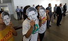 Activists hold up masks bearing the face of NSA leaker Edward Snowden at an internet conference in Brazil.