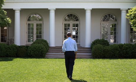 President Obama walks through the Rose Garden of the White House on May 6, 2014.