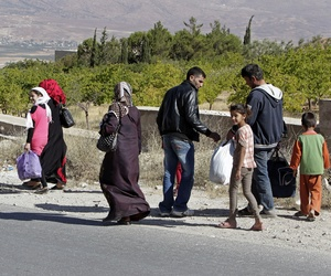 Syrian family flees from Arsal, a town near the Syrian border in eastern Lebanon, on August 4, 2014.