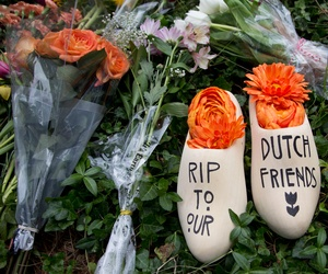 A message of sympathy for the victims of the flight MH17 disaster, is written on a wooden klomp, a traditional Dutch footwear for farmers, placed together with bouquet of flowers in front of the Netherlands Embassy in Washington, July 21, 2014.