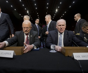 Director of National Intelligence James Clapper and CIA Director John Brennan prepare to testify before the Senate Intelligence Committee on Capitol Hill on January 29, 2014.