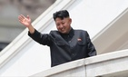 North Korean leader Kim Jong Un waves to war veterans during a military parade celebrating the 60th anniversary of the Korean War armistice in Pyongyang, North Korea.