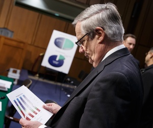 Pentagon Comptroller Robert Hale prepares to testify at a Senate Armed Services Committee hearing focusing on the Defense Department's budget request for fiscal year 2015, on Capitol Hill in Washington, March 5, 2014.