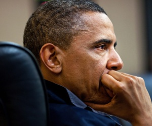 President Barack Obama listens during one in a series of meetings discussing the mission against Osama bin Laden, in the Situation Room of the White House.