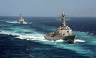 The USS Kidd and USS Pinckney participate in a training unit exercise off of the Southern California coast.
