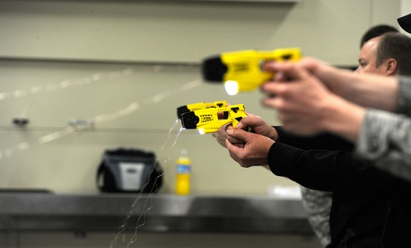 Airmen with the 75th Security Forces Squadron shoot X26 Tasers during a training course on Hill Air Force Base, Utah.