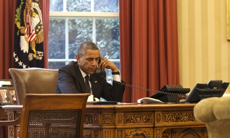 President Obama speaks with Jordan's King Abdullah II on the phone in the Oval Office, on August 8, 2014.