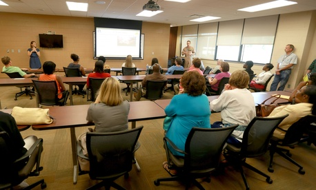Civilian Marines aboard the Air Station hold a quarterly meeting to welcome new employees and discuss other programs.