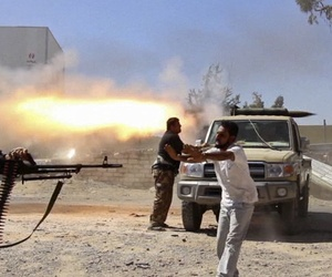 Fighters with the Misarata brigade fire towards Tripoli airport in an attempt to take control of the position from a rival militia, on July 26, 2014.