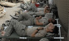 Soldiers from the 1st Battalion sleep outdoors at Sadr City on March 31.