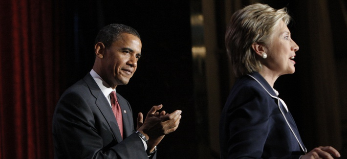Then presidential candidate Sen. Barack Obama, D-Ill., applauds as he is introduced by Sen. Hillary Clinton, D-N.Y., during a campaign stop in New York, in July 2008.