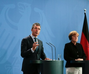 German Chancellor Angela Merkel, right, and NATO Secretary General Anders Fogh Rasmussen brief the media after a meeting at the chancellery in Berlin, Wednesday, July 2, 2014.