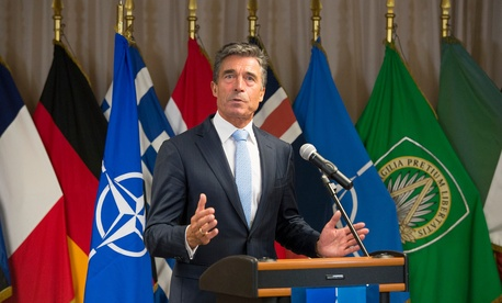 NATO Secretary General Anders Fogh Rasmussen delivers a statement to the press after meeting with British Prime Minister David Cameron at Supreme Headquarters Allied Command Operations.