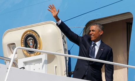 President Barack Obama on Tuesday waves as he boards Air Force One at Andrews Air Force Base, Md..