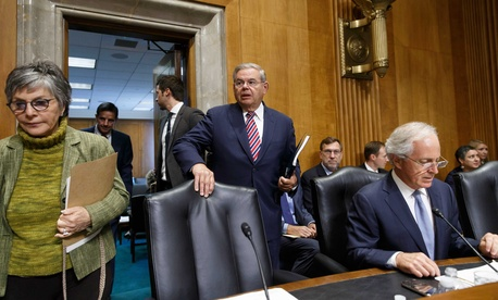Senate Foreign Relations Committee Chairman Bob Menendez, D-N.J.,  arrives for a hearing on Capitol Hill, on July 17, 2014.