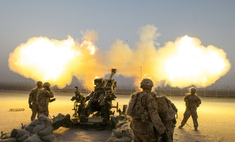 Soldiers with the 4th Infantry Brigade Combat Team shoot a round downrange from a howitzer on Kandahar Airfield, Afghanistan.