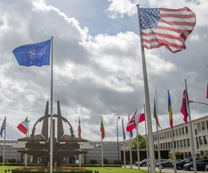Flags of NATO member states flap in the wind outside of the alliance's headquarters in Brussels, Belgium.