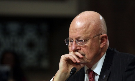 Director of National Intelligence James Clapper pauses while testifying on Capitol Hill in Washington, Feb. 11, 2014, before the Senate Armed Services Committee hearing on entitled Current and Future Worldwide Threats.