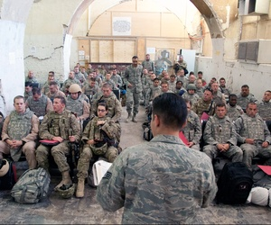 A U.S. Airman welcomes more than 50 newly-arrived airmen at the inbound passenger terminal at Kandahar Airfield, Afghanistan, Sept. 13, 2011.