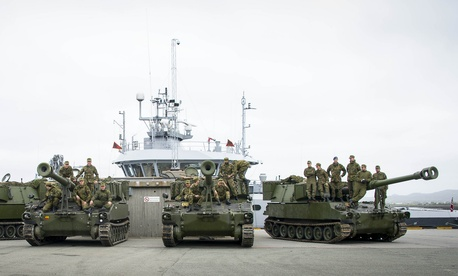 As part of NATO's Unified Vision 2014 exercise, a Norwegian artillery unit sets up its self-propelled howitzers.
