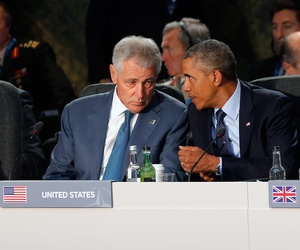 U.S. President Barack Obama speaks with U.S. Defense Secretary Chuck Hagel at a leaders meeting on the future of NATO at Celtic Manor, Newport, Wales, Sept. 5, 2014.
