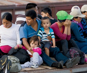 Central American migrants ride a freight train during their journey toward the U.S.-Mexico border.