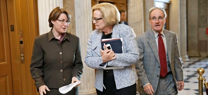 Sens. Amy Klobuchar, D-Minn, Claire McCaskill, D-Mo., and James Risch, R-Idaho, arrive for a vote on Capitol Hill.