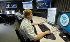 "A cyber security analyst works in the ""watch and warning center"" during a tour of the government's cyber defense lab in Idaho Falls, Idaho."