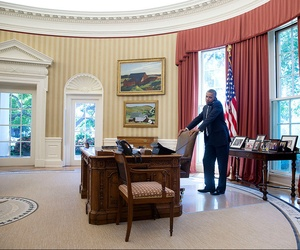 President Obama speaks on the phone in the Oval Office with Abdullah Abdullah on July 25, 2014.