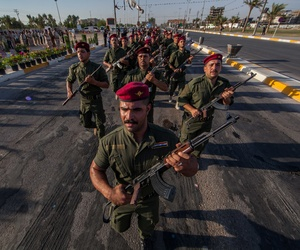 Volunteers in the newly formed Abbas Brigades parade near the Imam Hussein shrine in Karbala, Iraq, on August 14, 2014.
