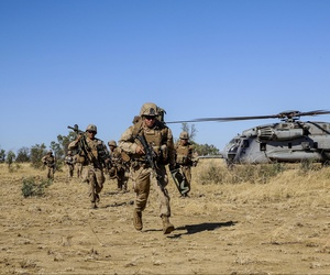 Marines with the Marine Rotational Force-Darwin conduct a helicopter-insert during a live-fire exercise at Bradshaw Field Training Area during Exercise Koolendong in August 2014.