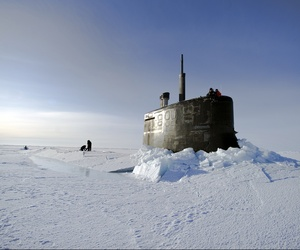 Sailors and members of the Applied Physics Laboratory Ice Station clear ice from the hatch of the USS Connecticut as it surfaces during ICEX 2011.