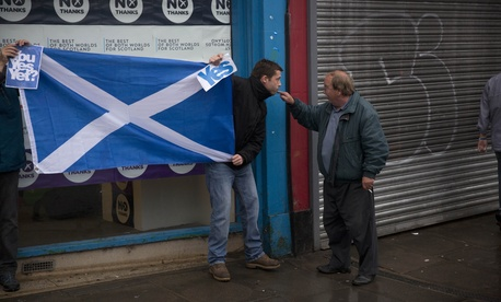 A passerby argues with two supports of Scottish independence movement in Edinburgh, Scotland, on September 15, 2014.